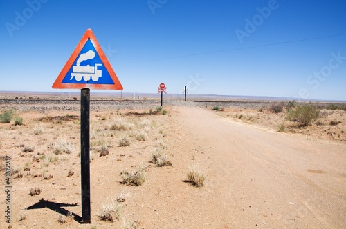 Warning of road sign - train cross the road, Namibia