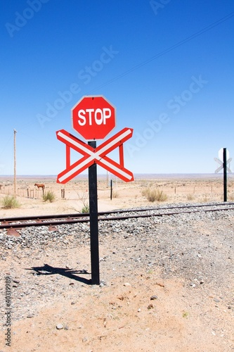 Warning of road sign - stop and railway cross the road, Namibia