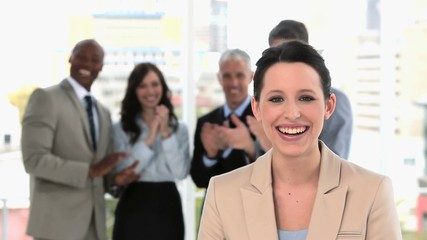 Smiling businesswoman being acclaimed