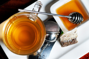 tea with honey on a plate