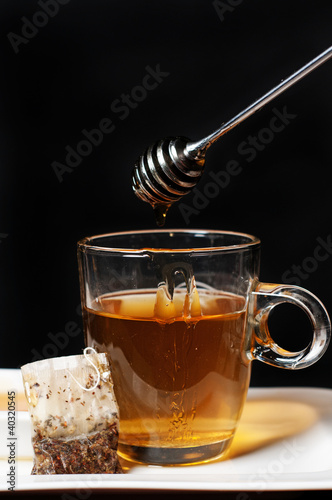 tea with honey being dripped in