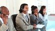 Happy call centre agents working with headsets