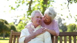 Retired woman embracing her husband