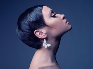 Sensual lady with earring-butterfly