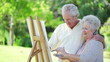 Retired couple painting together