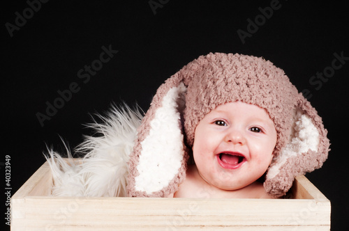 smiling baby with Easter bunny ears