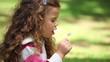 Girl blowing on a dandelion
