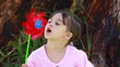 Happy little girl blowing on a pinwheel