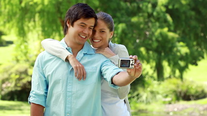 Happy couple taking themselves in picture