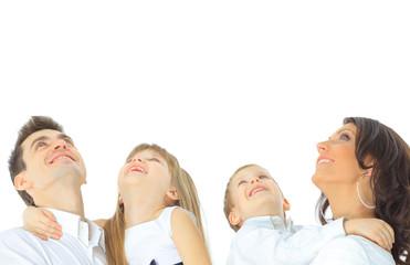 Photo of happy family looking upwards on white background