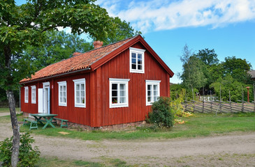 typical scandinavian red wooden house in village