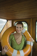 Young woman with inflatable ring, smiling, portrait