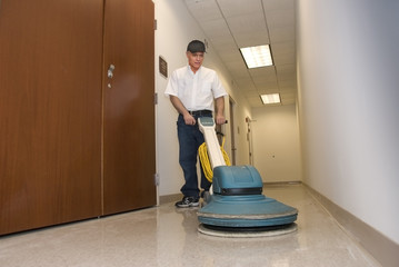 Cleaning floors with a buffing machine