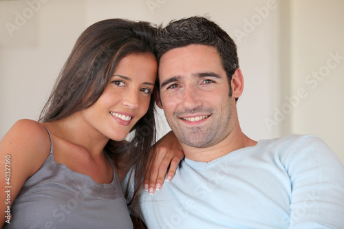 Couple relaxing at home in sofa