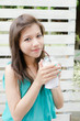 Attractive Asian Woman enjoy her drink