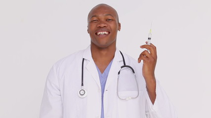 Smiling doctor holding a syringe