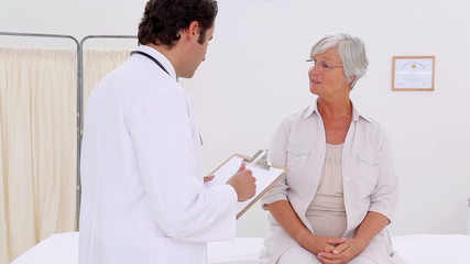 Smiling patient talking with her practitioner