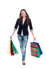 happy cute young woman shopping with color bags