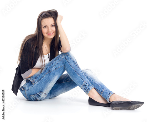 Attractive teenage girl sitting on the floor