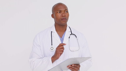 Serious doctor holding a clipboard