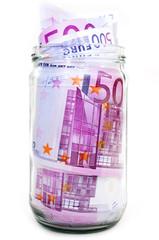 euro banknotes in money jar