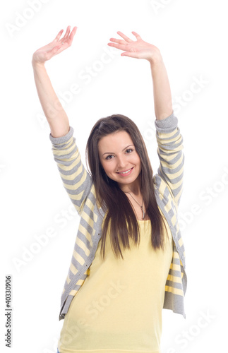 happy attractive young girl with her hands up