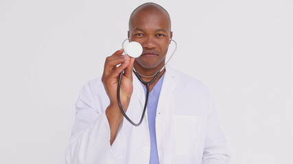 Happy practitioner showing his stethoscope