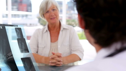 Mature woman listening to the explanations of the doctor