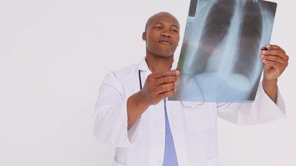 Happy practitioner holding a chest x-ray