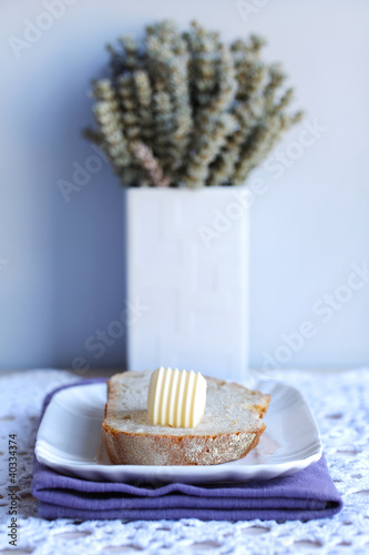 Bread and butter for breakfast with a lavender bouquet