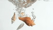 Conch shells in a super slow motion falling in the water