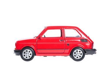 Small red car on white background.
