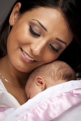 Attractive Ethnic Woman with Her Newborn Baby