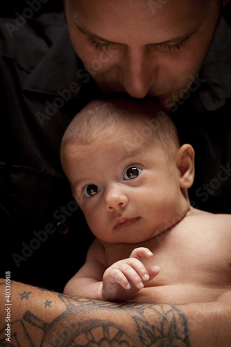 Young Father Holding His Mixed Race Newborn Baby
