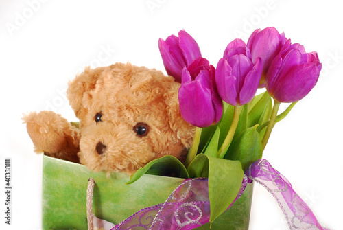tulips and teddy bear in gift bag