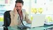 Businesswoman receiving a good news by phone