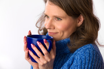 Caucasian woman holding teacup