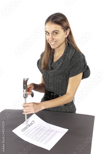 Metaphor businesswoman nails contract agreement