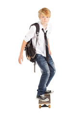 teen boy on skateboard isolated on white