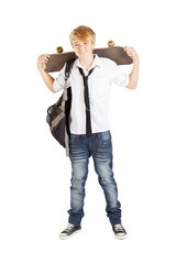 teen schoolboy with skateboard isolated on white