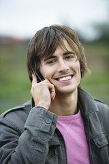 Young man using mobile phone, portrait