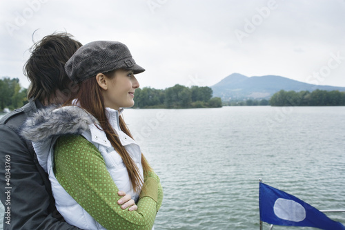 Young couple smiling by river