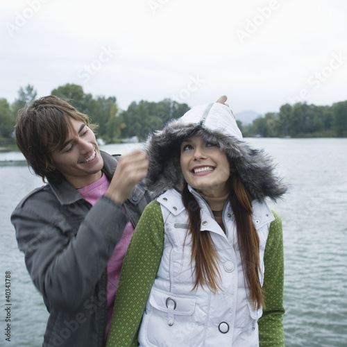 Young couple enjoying in front of river