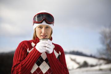 Mid adult woman holding mug, portrait