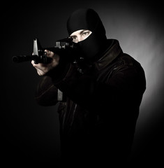 criminal with rifle