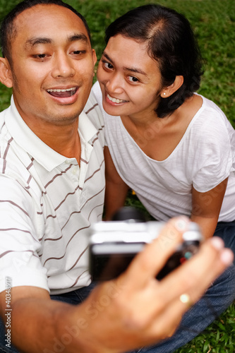 ethnic couple taking self portrait