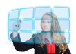 Business woman pointing to empty blue virtual screen