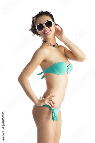 girl in beach wear with sunglasses with body turned in profile