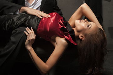 Young beauty lying on man's tights