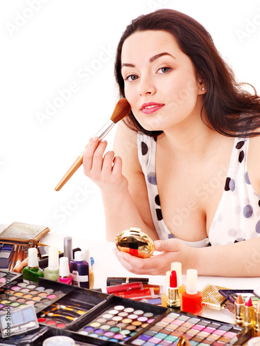 Girl applying makeup.